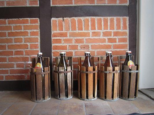 Old bottles used to carry beer from the Ugly Duck brewery, still in use by some of the locals